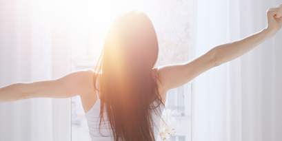 Woman wakes up feeling refreshed after understanding her sleep chronotype.