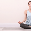 A young woman practices loving-kindness meditation to help reduce stress and manage anxiety.